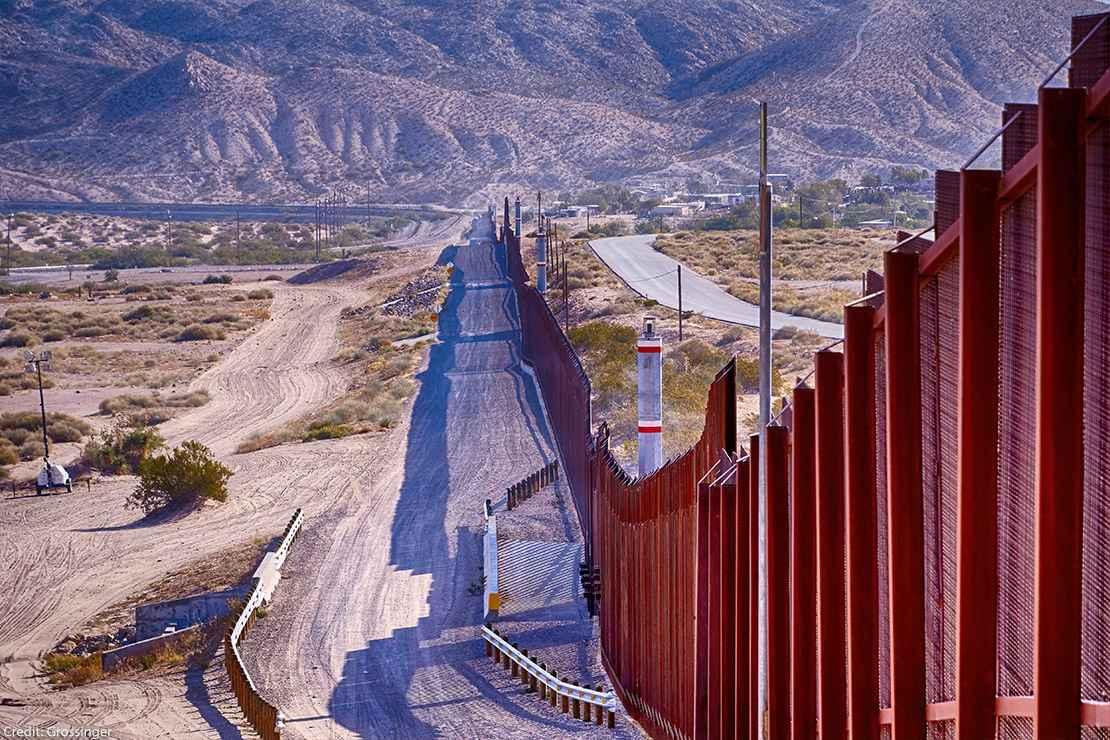 El Paso, Texas border wall between USA and Mexico running thru the desert.