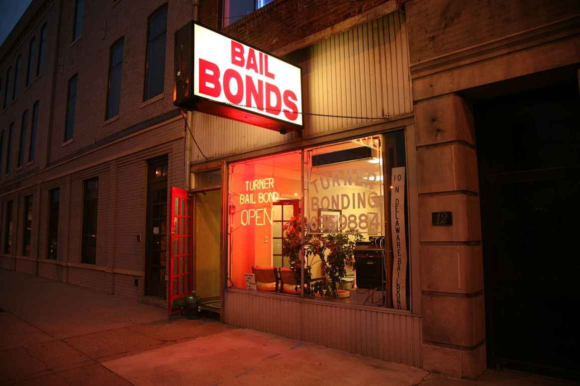 Photo of the outside of a bail bond office at night time