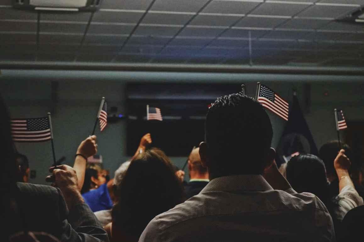 Title 42 Op-Ed, Immigrants Waving American Flags