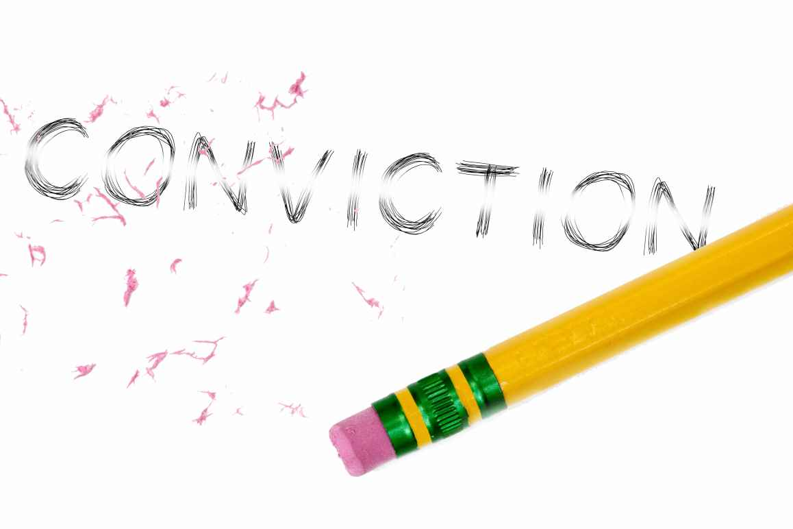 The word conviction being erased