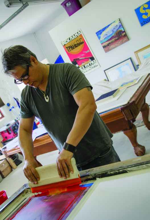 Mateo Romero working in his studio.