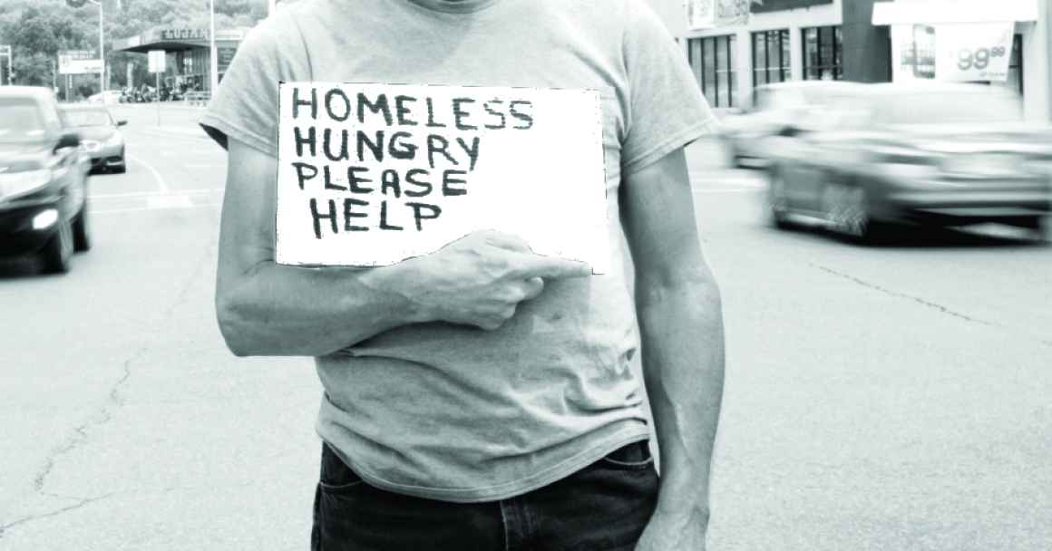 Man holding sign soliciting donations